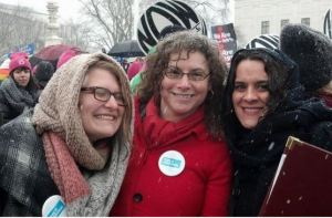 Becka with two of her badass feminist colleagues rallying for the right to affordable, accessible birth control.