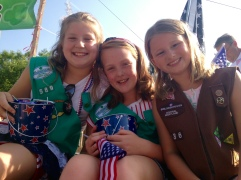 Anyone who thinks girls can't do what boys can do needs to think again, said 9-year-old Julia, left. Her friends, Maddie, 9, center, and Riley, 8, right, nodded their heads in approval, adding they look much better in their uniforms than Boy Scouts. Julia and Riley want to become veterinarians while Maddie has plans to be a scientist.