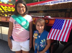 Gia, 9, left, and her younger sister, Alessandra, are part of a troop led by their fabulous mom who believes it's a parent's responsibility to raise strong girls. Gia said being a girl means you can be whatever you want to be, including becoming a famous singer. Anyone who says differently is just wrong!