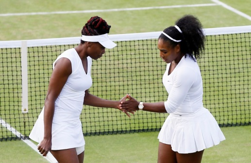 Venus Williams, left, and Serena Williams of the U.s celebrate a point against Lucie Hradecka and Andrea Hlavackova of the Czech Republic during their women's doubles match on day nine of the Wimbledon Tennis Championships in London, Tuesday, July 5, 2016. (AP Photo/Kirsty Wigglesworth)